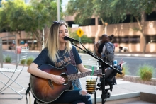 ASU Alumn, Laura Walsh, entertains people at the ASU Open Door event on the Downtown Phoenix campus.