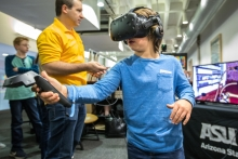 Nine-year-old J.P. Corens, of Phoenix, turns on the faucet through virtual reality at the ASU Preparatory Academy's display at the Downtown Phoenix campus' ASU Open Door, on Friday, Feb. 2, 2018