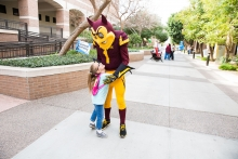 Sparky gets a hug from Hailey Scherf during Open Door at West Campus on Saturday Feb. 10th, 2018 in Glendale, Ariz.