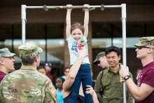 Olivia Sibrava gets a little help from mom to complete the ASU Army ROTC pull up challenge during ASU Open Door at West Campus on Saturday Feb. 10th, 2018 in Glendale, Ariz.