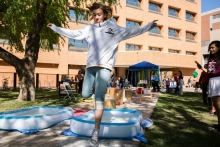 Elliot Holst runs across a pool of cornstarch in a photosynthesis electron transfer obstacle course at the Tempe campus on Feb. 24, 2018 for ASU Open Door.